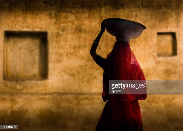 A picture of an Indian woman in a red dress