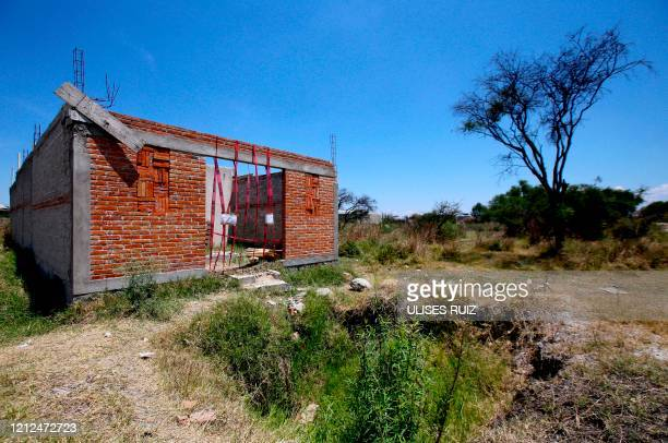 Picture of an unfinished construction at the farm where remains of at least 25 people were found buried in a clandestine mass grave in the...