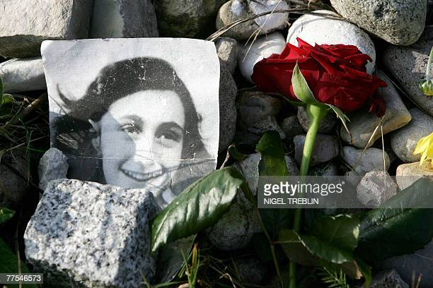 A picture of Anne Frank lies in front of the memorial stone for Jewish girl Anne Frank author of The Diary of a Young Girl and her sister Margot 28...