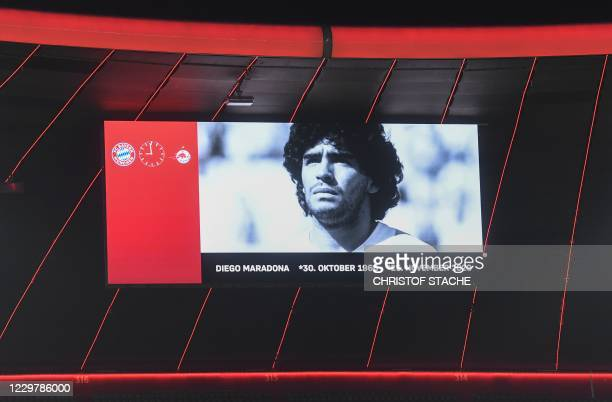 Picture of Argentine football legend Diego Maradona is seen as players observe a minutes' silence in his memory prior to the UEFA Champions League...