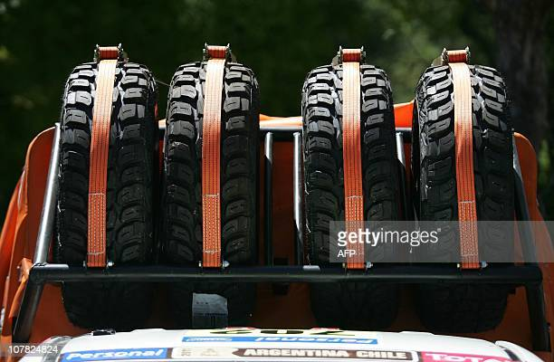 Picture of backup tyres of a vehicle participating in the Dakar 2011 Rally, seen on the roof of an assistance car, during the technical verification...