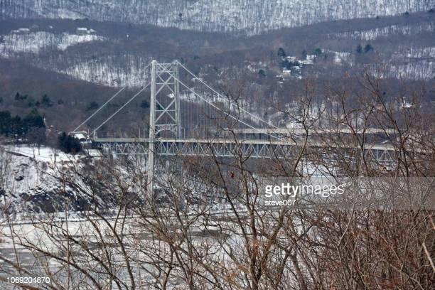 picture of bear mountain bridge taken on a winding road leading to the bear mountain bridge in westchester county. photo taken saturday february 8, 2014. - bear mountain bridge stock pictures, royalty-free photos & images