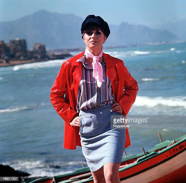 1967 A picture of British actress Joanna Lumley modeling some fashionable clothes of the time as she poses on a cliff overlooking the sea