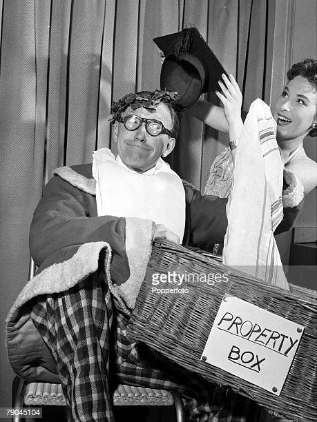 1954 A picture of British comedian Arthur Askey clowning around with his daughter Anthea