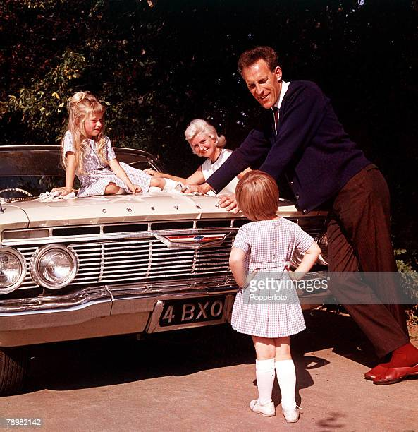 1961 A picture of British entertainer Bruce Forsyth and his wife Penny and children leaning on his car