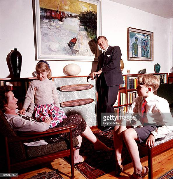 1962 A picture of British naturalist and broadcaster David Attenborough at home with his family