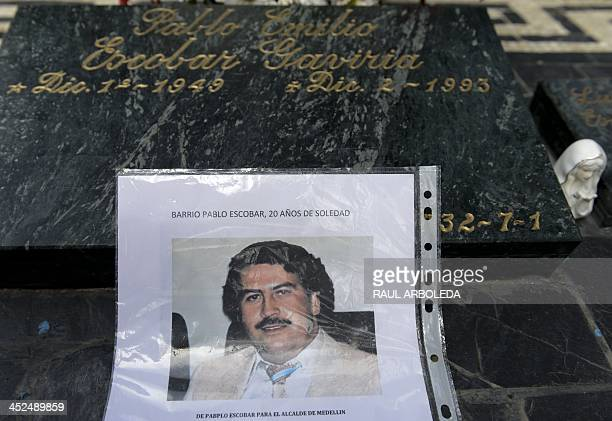 Picture of Colombian drug lord Pablo Escobar is seen over his tomb on November 29, 2013 at Montesacro cemetery in Medellin, Antioquia department,...