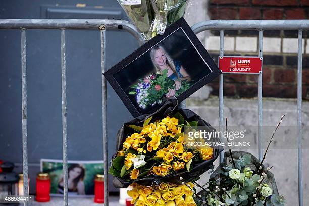 Picture of Dace Zarina with flowers hooked to a safety barrier in front of her destroyed university residence commemorates the deceased student who...