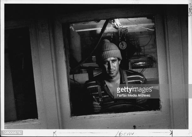 """Picture of Dick Bagnato the skipper of the fishing vessel, """"Seaport"""" contemplating heavy weather.""""It always looks small at sea. Anything can happen...."""