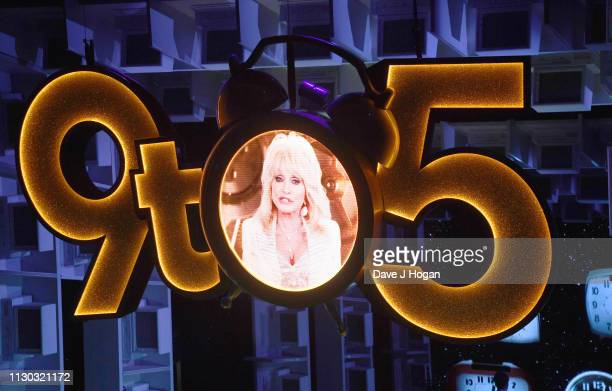 A picture of Dolly Parton is included in3 the set design during 9 To 5 The Musical at The Savoy Theatre on February 17 2019 in London England