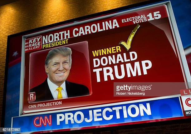 A picture of Donald J Trump appears on a CNN television program after the Republican party nominee won the vote from the state of North Carolina at...
