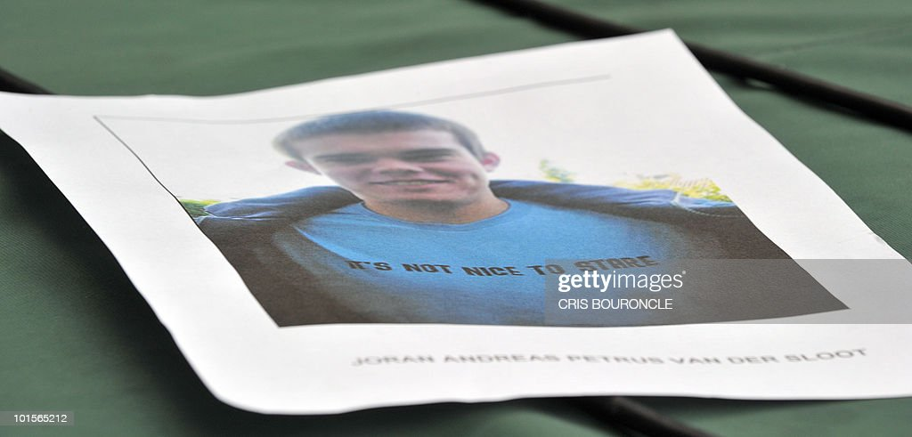 A picture of Dutch citizen Joran van Der Sloot, 23, is shown June 2, 2010 in Lima, moments before a press conference by Gen. Cesar Guardia Vasquez, chief of the criminal investigation department of the Peruvian police, where van Der Sloot was signaled as the main suspect in the murder of Peruvian woman Stephany Flores Ramirez, 21, found dead in his room at a local hotel today, after they were seen together in a casino on Saturday. Guardia announced that Van Der Sloot has crossed the border with Chile. Flores was the daughter of businessman and race driver Ricardo Flores.