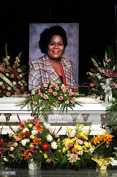 A picture of Earnestine Harper is displayed over her casket at the funeral for her and four family members who were found shot to death in their home...
