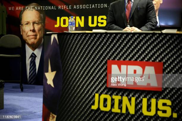 A picture of Executive Vice President Wayne LaPierre is seen at the National Rifle Association booth during CPAC 2019 February 28 2019 in National...