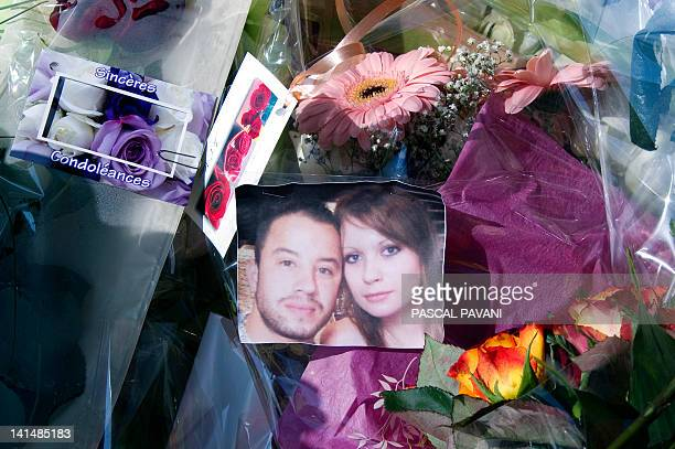A picture of French corporal Abel Chennouf and his pregnant companion is placed between flowers on March 17 2012 in the southwestern city of...