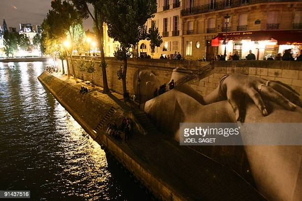 A picture of French photographer JR is displayed on a wall of the bank of the River Seine as part of the Paris annual roundtheclock culture festival...