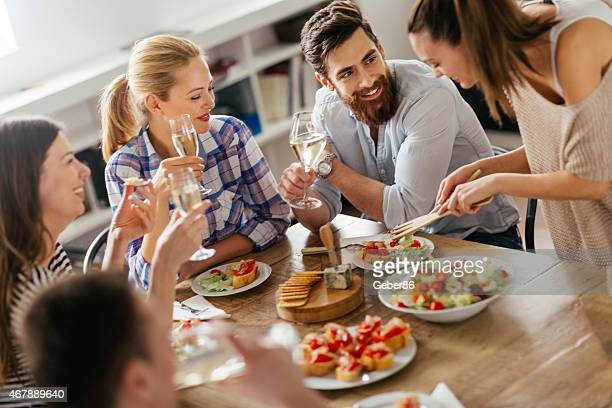 Picture of friends having a nice meal with wine together