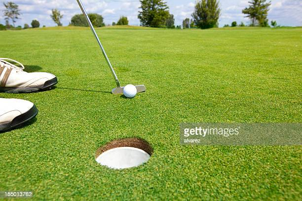 picture of golfer putting a ball - putting green stock pictures, royalty-free photos & images