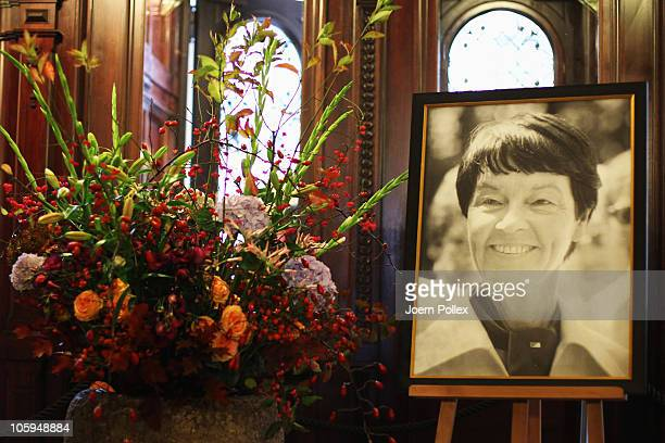 A picture of Hannelore 'Loki' Schmidt and flowers are seen near a book of condolence for Hannelore 'Loki' Schmidt at City Hall on October 22 2010 in...