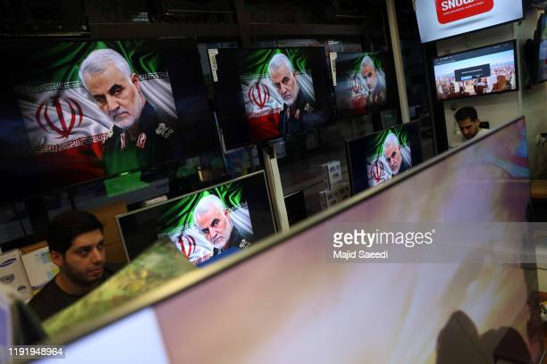 A picture of Iranian revolutionary guard Gen Qaseem Soleimani is seen in an electronic store on January 5 2020 in downtown Tehran Iran General Qasem...