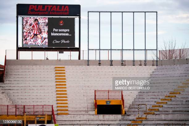 Picture of Italys football player Paolo Rossi is projected on an electronic bill board as his coffin is on public display in the Romeo Menti stadium...