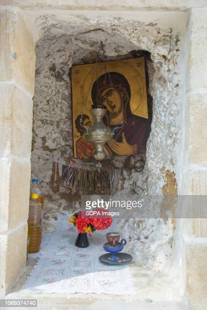 A picture of Jesus and the Virgin Mary in a small shrine at the Panagia Chrysoskalitissa Monastery The Panagia Chrysoskalitissa Monastery is a...