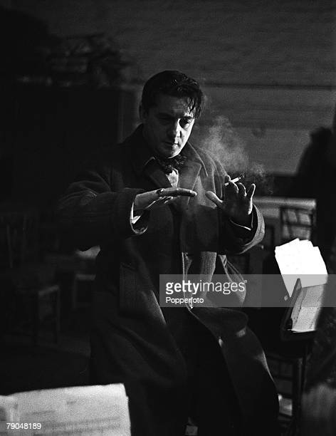 Picture of John Barbirolli , the famous British musical conductor, conducting the Halle Orchestra