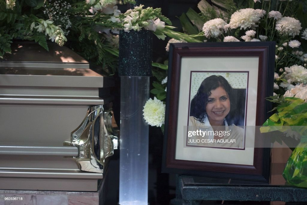 A Picture Of Journalist Alicia Diaz Gonzalez Sits Next To Her Coffin During The Funeral In