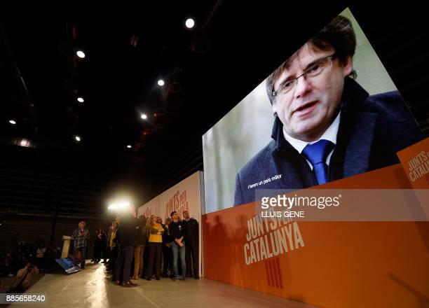 A picture of 'Junts per Catalonia' grouping cadidate for the upcoming Catalan regional election Carles Puigdemont is displayed on a screen during the...