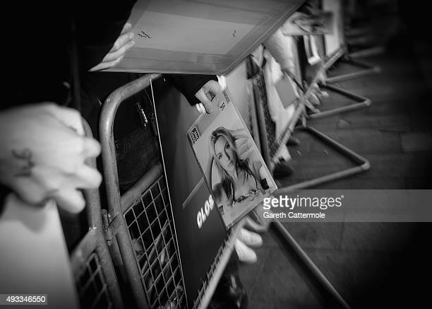 A picture of Kate Winslet is held out to be signed during the 'Steve Jobs' Closing Night Gala during the BFI London Film Festival at Odeon Leicester...