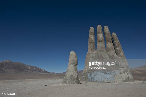 A picture of La Mano del Desierto an 11 metertall monument by Chilean sculptor Mario Irarrazabal produced in 1992 is seen in the outskirts of...