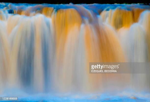 Picture of La Perla waterfall at the La Ponderosa Adventure Park in Guanacaste, Costa Rica, taken on August 22 amid the COVID-19 novel coronavirus...