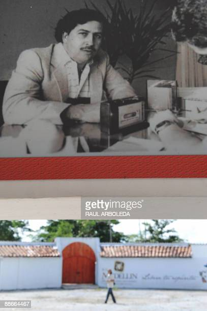 STORY A picture of late drug trafficker Pablo Escobar is hung from a wall inside the Napoles ranch thematic park in Puerto Triunfo municipality...