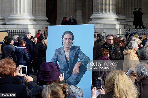A picture of late French singer Michel Delpech is pictured following his funeral ceremony on January 8 2016 at SaintSulpice church in Paris French...