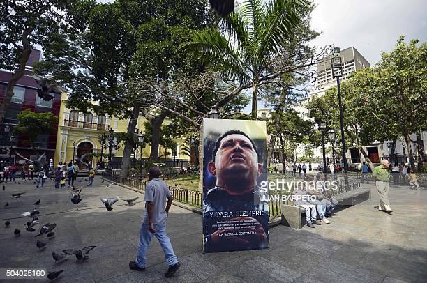 A picture of late President Hugo Chavez stands in Simon Bolivar square in Caracas on January 8 2016 Progovernment legislators announced Thursday that...