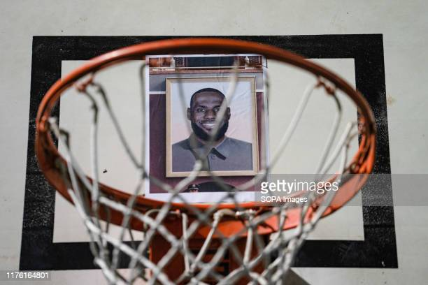 Picture of Lebron James stuck on the hoop during the demonstration Hundreds of protesters gathered to express their anger about Lebron James's tweet...
