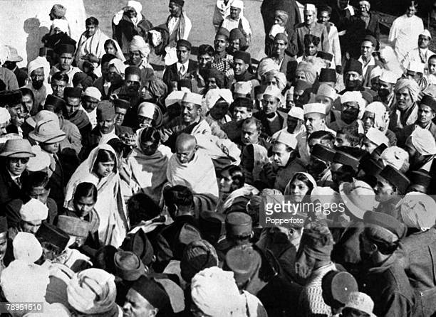 A picture of Mahatma Gandhi the Indian political and spiritual leader guru and social reformer with a crowd of his followers