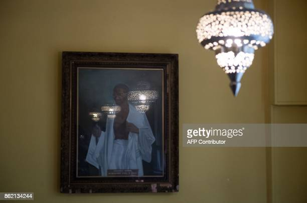 A picture of Mahatma Ghandi is pictured inside inside the India Club restaurant in London on October 16 2017 Plans to renovate a historic and beloved...