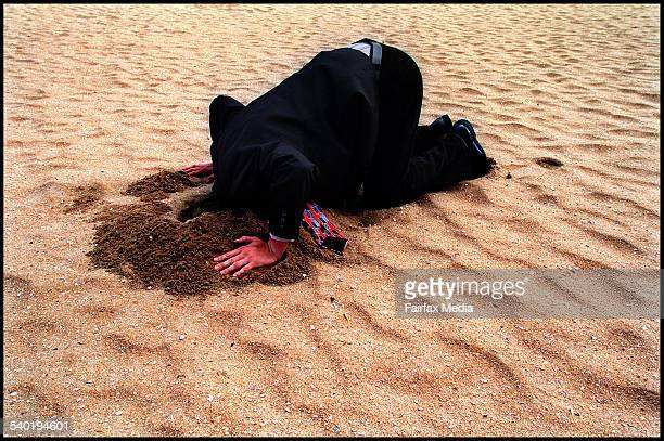 Picture of man in suit with his head in the sand 27 February 2002 AFR Picture by GABRIELE CHAROTTE