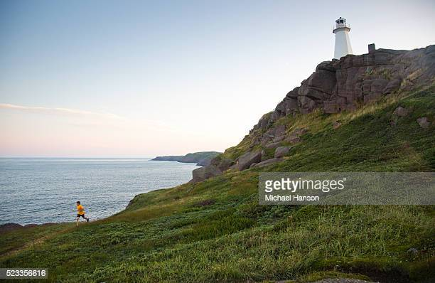 picture of man running, st. john's, newfoundland and labrador, canada - st. john's newfoundland stock photos and pictures
