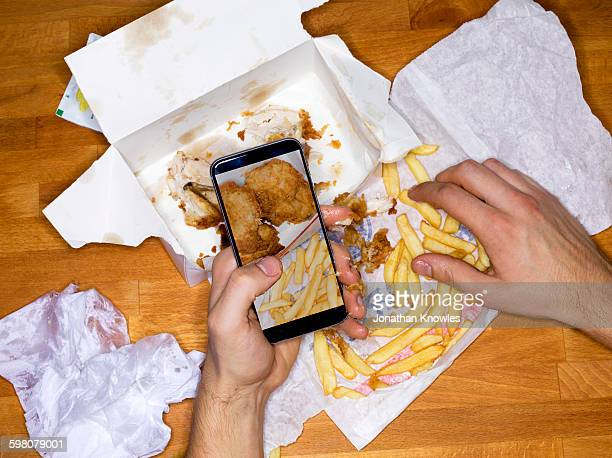 Picture of meal on mobile phone, greasy hands