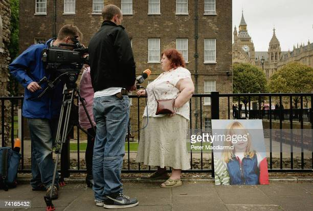 A picture of missing toddler Madeleine McCann is propped against a fence beside her aunt Philomena McCann as she gives television interviews after...