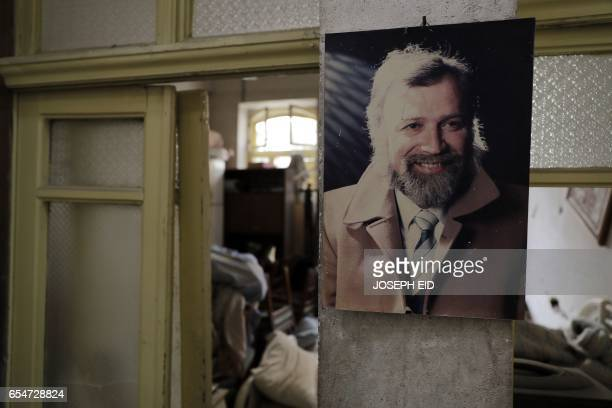A picture of Mohammed Mohiedin Anis or Abu Omar hangs in his house in Aleppo's formerly rebelheld alShaar neighbourhood on March 9 2017 / AFP PHOTO /...