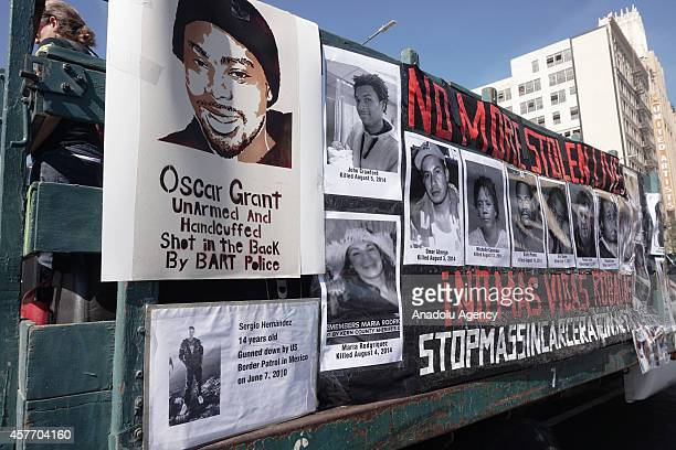 A picture of Oscar Grant who was fatally shot by a police officer on January 2009 is seen during the National Day of Protest to Stop Police Brutality...