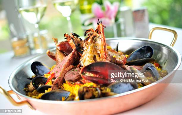Picture of paella with seared duck breast duck leg confit and grilled Boston lobster dish at Brasserie on the Eighth Conrad Hong Kong Admiralty...