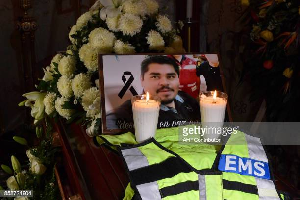 A picture of photojournalist Edgar Esqueda remains placed over his coffin during his wake in San Luis Potosi Mexico on October 7 2017 According to a...