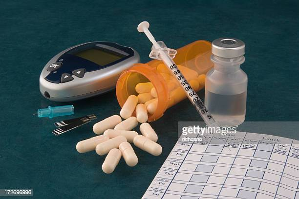 a picture of pills and diabetic supplies - diabetes stock pictures, royalty-free photos & images