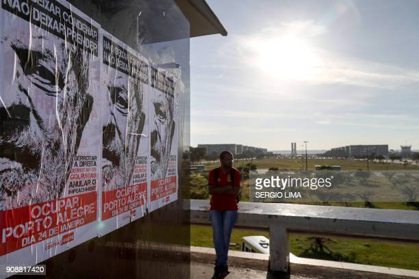 Picture of posters placed at a bus stop in Brasilia on January 22 2018 in support of Brazilian former President Luiz Inacio Lula de Silva calling for...