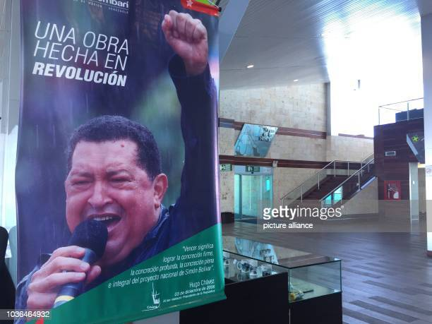 A picture of President Hugo Chávez deceased in 2013 and who initiated the project greets visitors at the summit station ofMerida's cableway in...