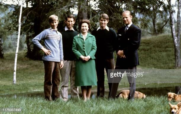Picture of Queen Elizabeth and Duke of Edinburgh posing with theirs three sons, Charles, Edward , Andrew and the royal corgies for their 32nd wedding...